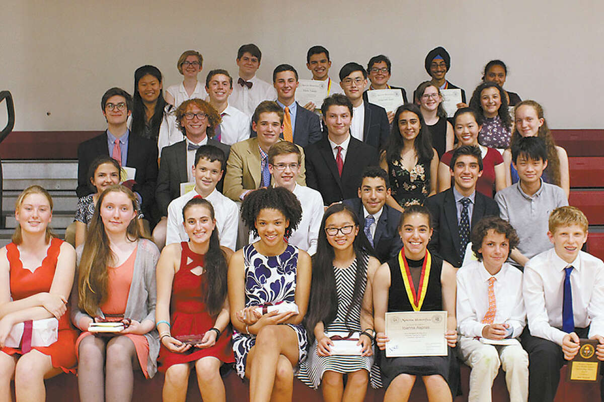 Alix Wadehra, third from right in the third row, and Bethany Eason, far left in the back row, were among the more than 30 Wooster students honored for academic excellence on May 30