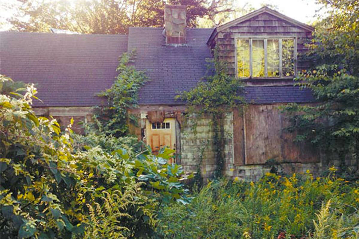 This vacant, deteriorating and overgrown has been cited as an example of a blighted house in the neighboring town of Ridgefield. -Ridgefield Press photo