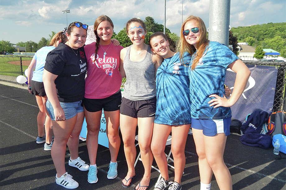 Top Inclusion Models team member Maddie Burke, DREAM Team member Lauren Robertson, and Glori Walk team members Callie Judelson, Aliana Rivas and Caroline Luciano at the Wilton High School track.