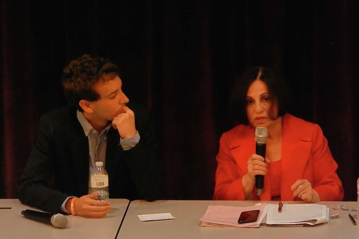 State Senator Toni Boucher speaks as Will Haskell listens at town hall-style meeting on guns. - Kendra Baker photo