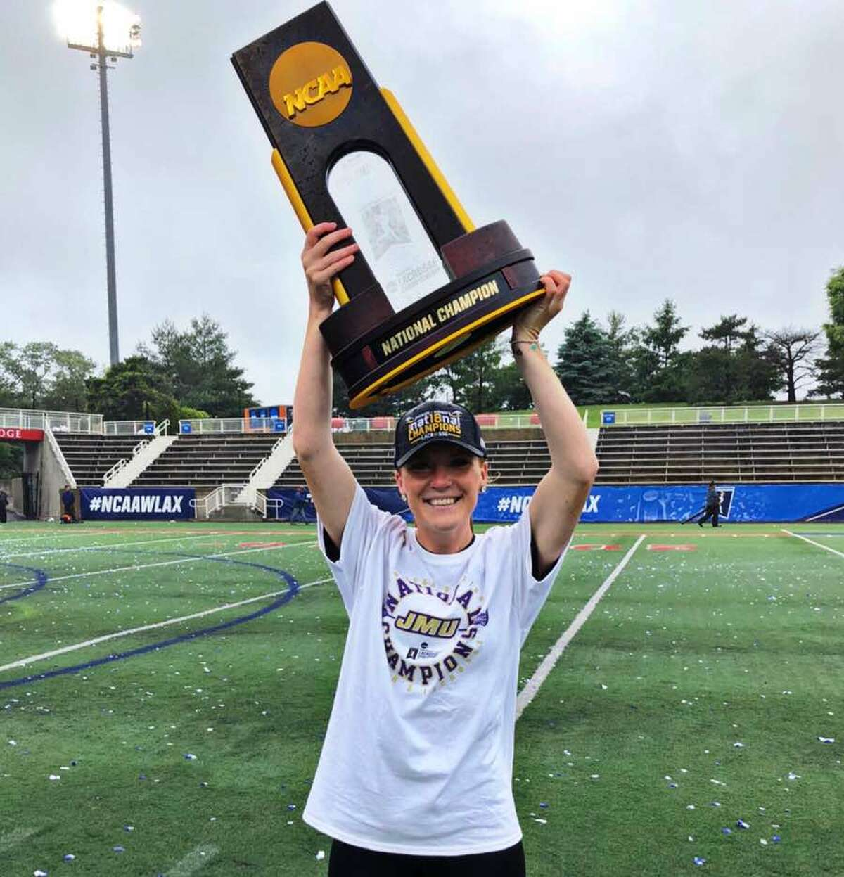 Shannon Quinlan hoists the NCAA Division I women's lacrosse championship trophy after James Madison's win over Boston College in the finals on May 27 in Stony Brook, N.Y.