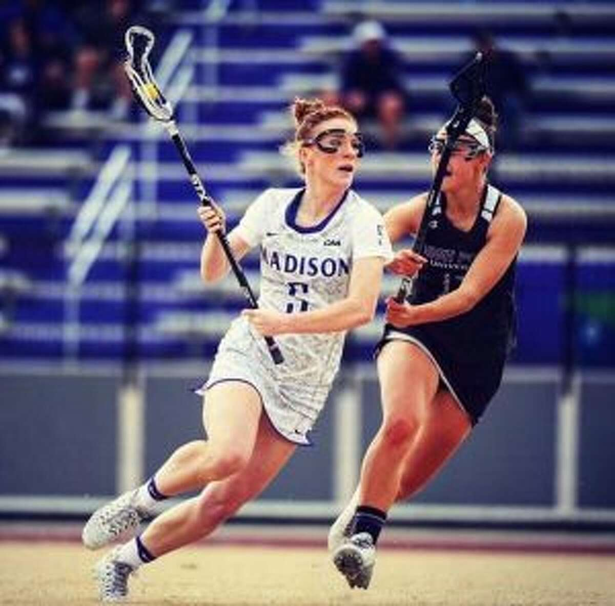 Shannon Quinlan goes on the attack during James Madison women's lacrosse action from last season. - JMA Athletics