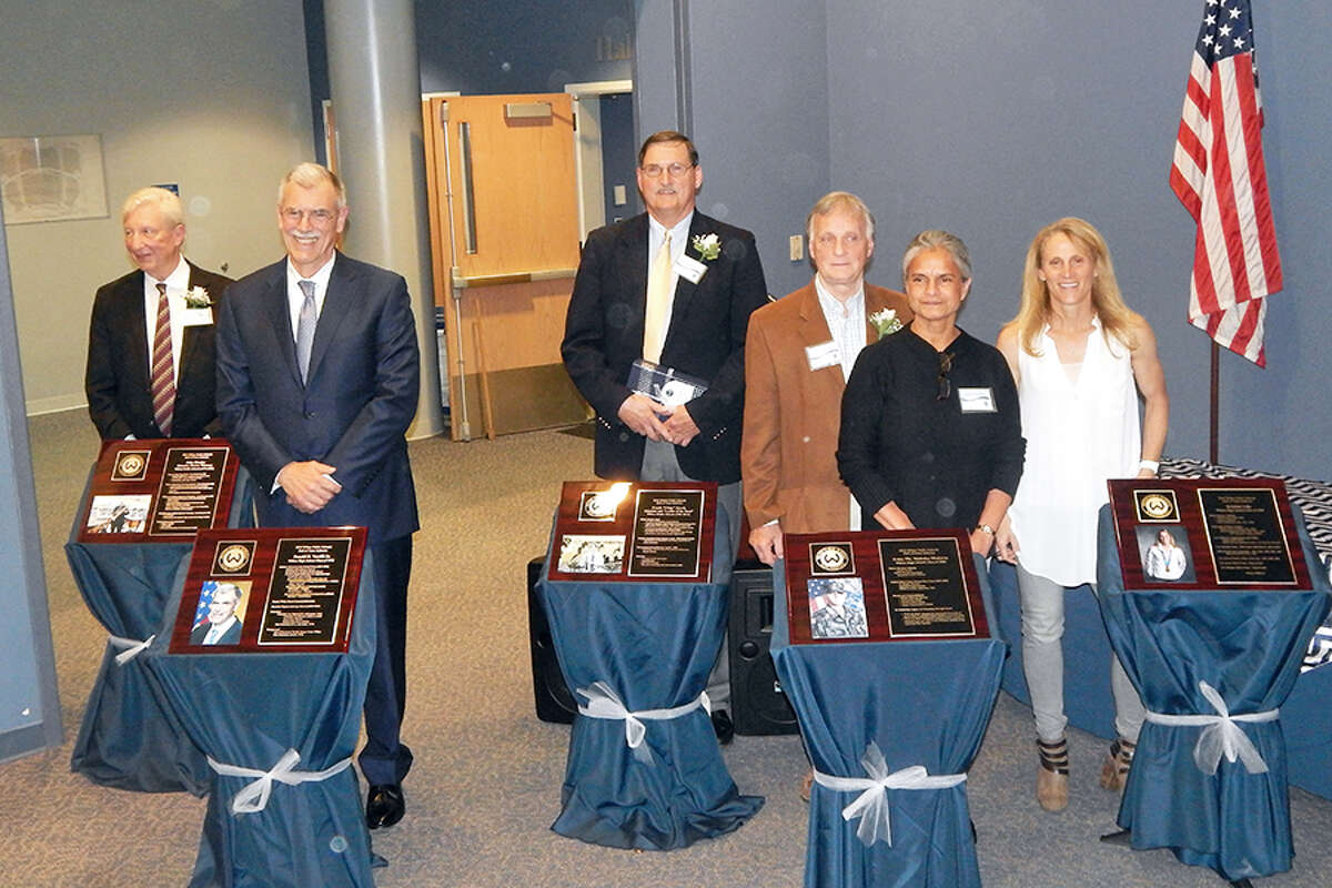 Wilton Hall of Fame inductees, from left, John Rhodes, Donald Verrilli Jr., Frank 'Chip' Gawle, Pfc Nicholas Madaras's parents William and Shalini Madaras, and Kristine Lilly.