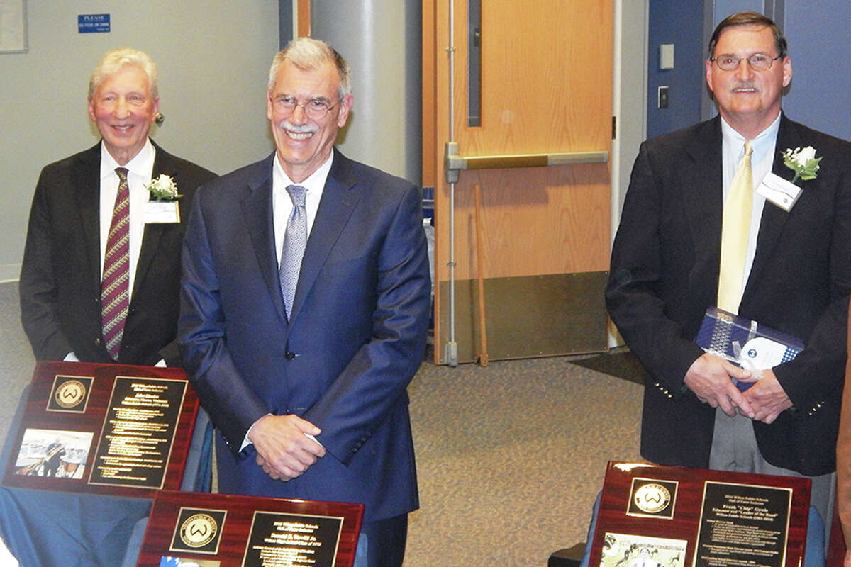 Wilton Hall of Fame inductees, from left, John Rhodes, Donald B. Verrilli Jr. and Frank 'Chip' Gawle stand behind their plaques.
