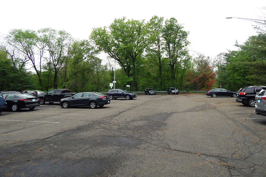Some of the cars parked in Wilton's Park and Ride at the Route 7 and Wolfpit Road intersection on Thursday, May 17. — Kendra Baker photo