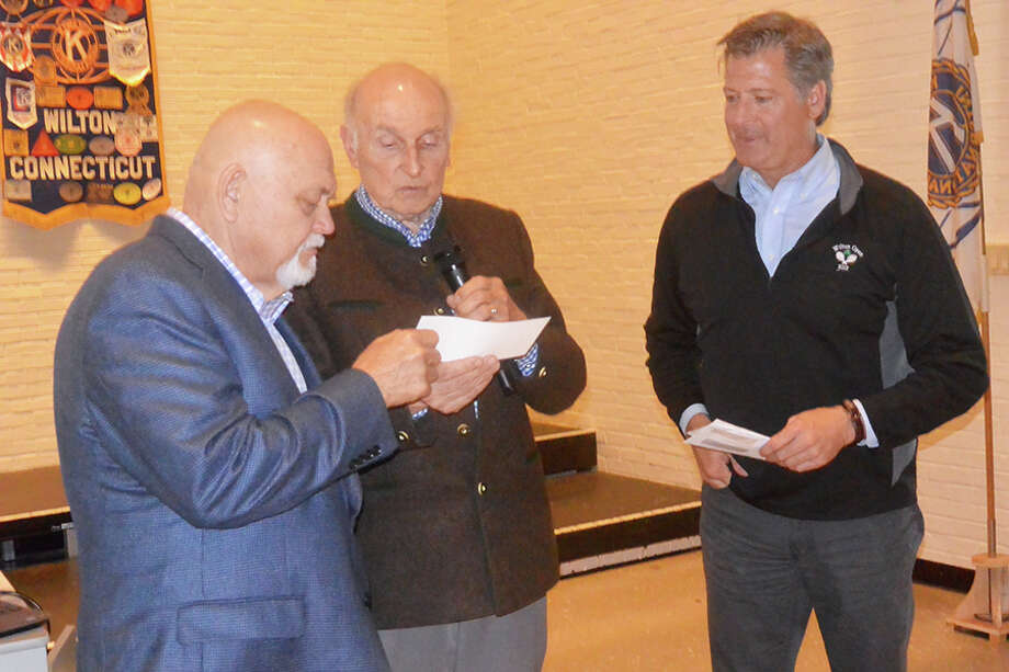 The Rev. Terry Wilcox, left, accepts checks from Fred Hans Sindel, center, and Bo Beatty. — Tony Spinelli photo