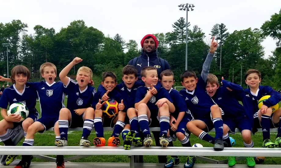 The Wilton Blue U-9 boys soccer team won two games at the Newtown Memorial Day Weekend Tournament. From the left: Jack Mulfinger, Joshua Comiskey, Liam Backman, Caio Thakur, Gavin Levenherz, Ryan Vermeulen, Sean Kaliski, Mario Coppola, Conor Filip, Jake Albanese and head coach Ritesh Mistry.