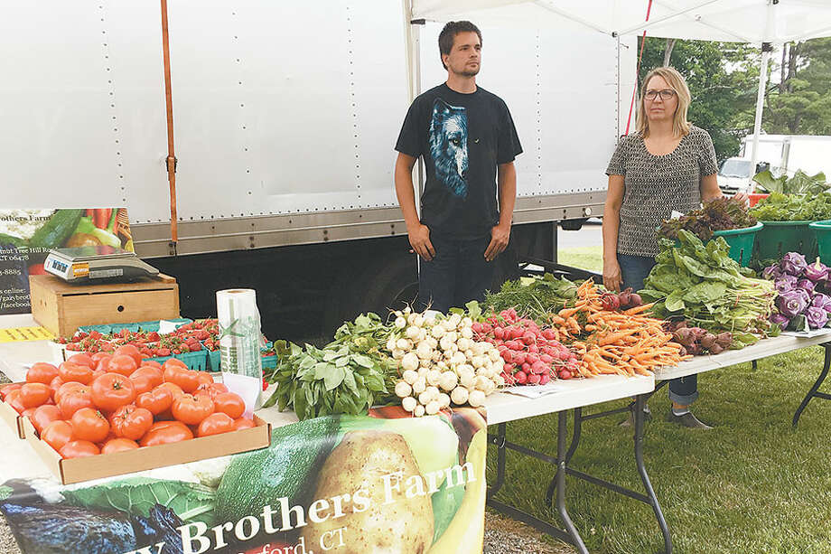 Workers from Gazy Brothers Farm in Oxford at last year's Wilton Farmers' Market. — Contributed photo