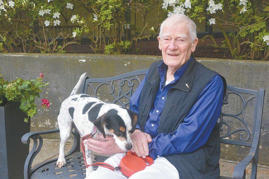 George Ongley outside his apartment building in Hamden with his beagle mix, Dilly. –Tony Spinelli photo