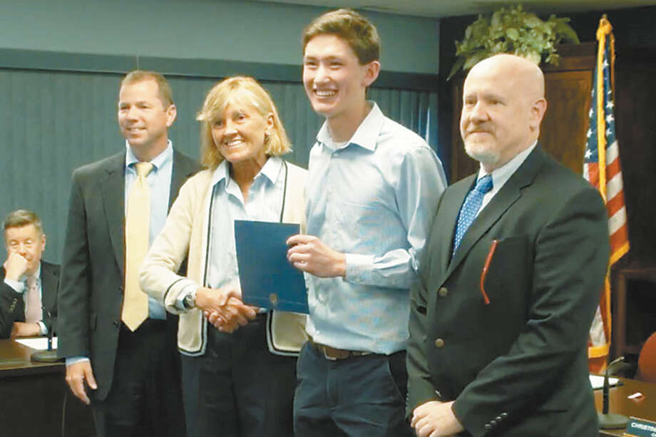 Andrew Noonan accepts his CABE Student Leadership Award from Superintendent Kevin Smith, Board of Education Chair Christine Finkelstein and Wilton High School Associate Principal Donald Schels.