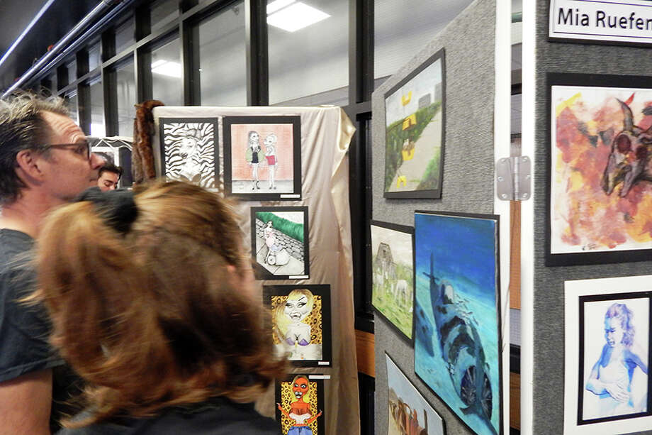 Visitors check out Wilton High School senior Mia Ruefenacht's art.