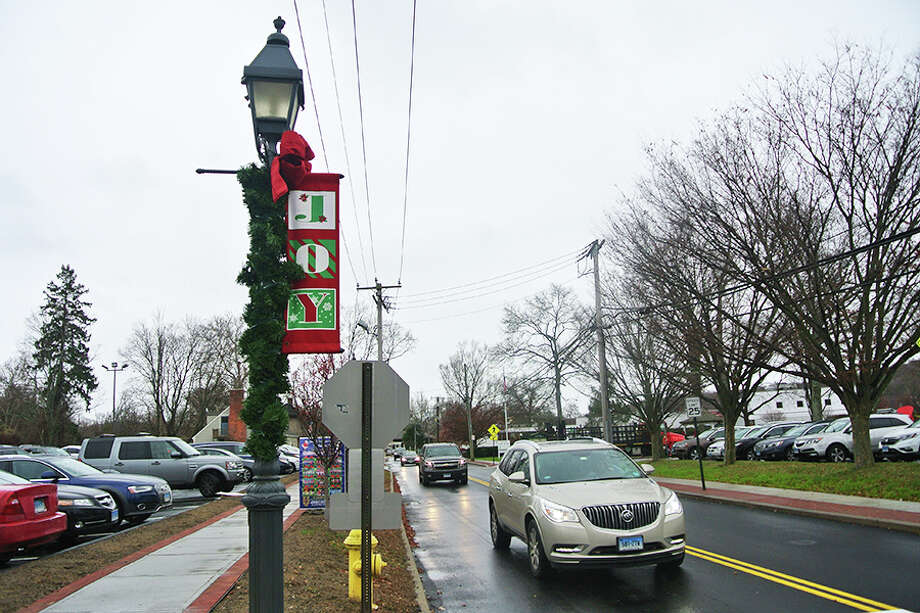 The group Enlighten Wilton would like to bring back the red-and-green Joy banners to replace the blue-and-white snowflake banners introduced during the winter holiday season in 2016.