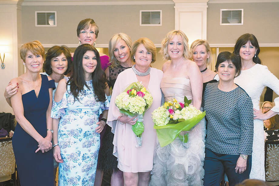 At the Wilton Woman's Club's fashion show fund-raiser this year are, from left, Sue Steitz, Jodi Meyer, Margaret Mazer Ogdon, Victoria Madden, Suzy Curtice, Jen Toll, Lorraine Winsor, Joanna Copley, BJ Bralower, and E. Chambers. — Peggy Garbus Photography / Peggy Garbus Photography