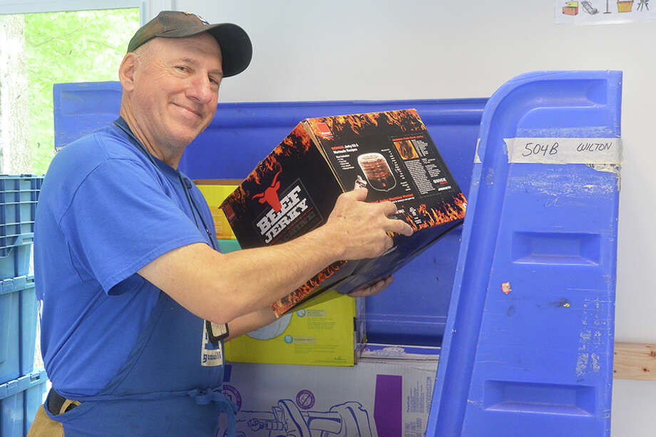 Goodwill donation center attendant Paul Bender of Trumbull loads a bin at the new Goodwill of Western and Northern Connecticut donation station on Danbury Road. — Tony Spinelli photo