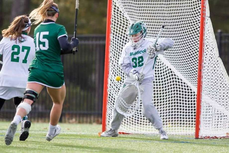 Olivia Phelan makes a save during Babson College women's lacrosse action from this season. — Photo courtesy Babson Athletics