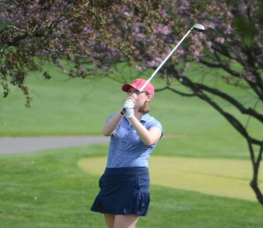 GiGi Hill follows her drive during the Wilton girls golf team's match last week in Danbury. — J.B. Cozens photo