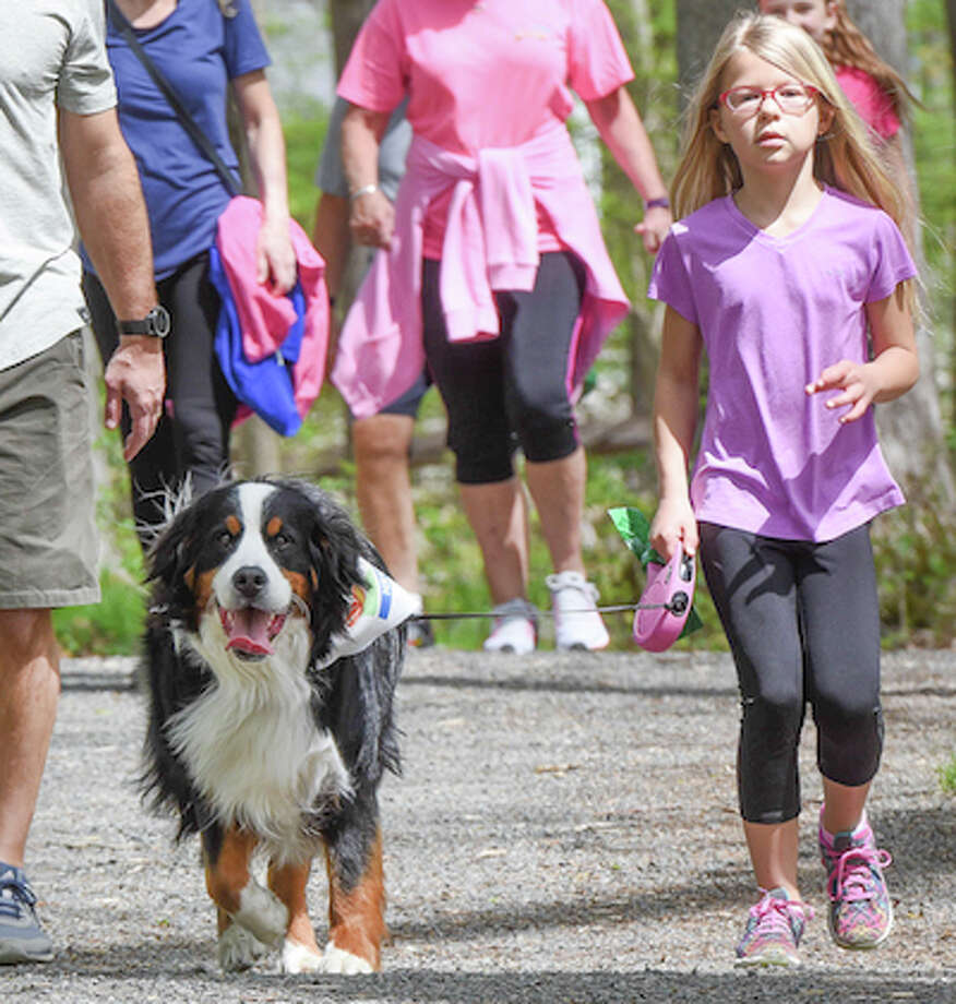 Maddie Soccio, 7, and Cali joined in the Mutt Strut last year. — Bryan Haeffele/Hearst Connecticut Media / BryanHaeffele