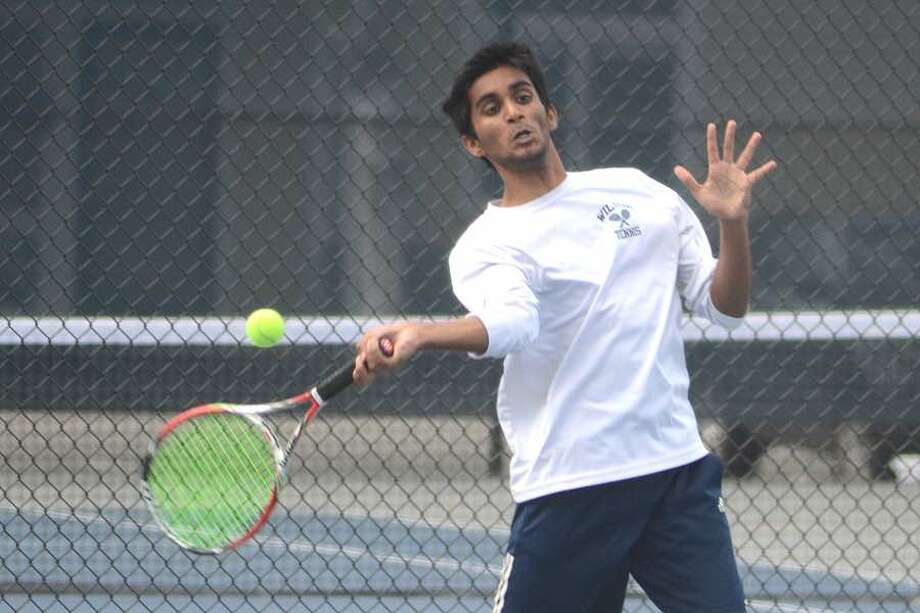 Rithwik Shivram gets a beat on the ball during the Wilton High boys tennis team's match on Monday against Danbury at home. — J.B. Cozens photo
