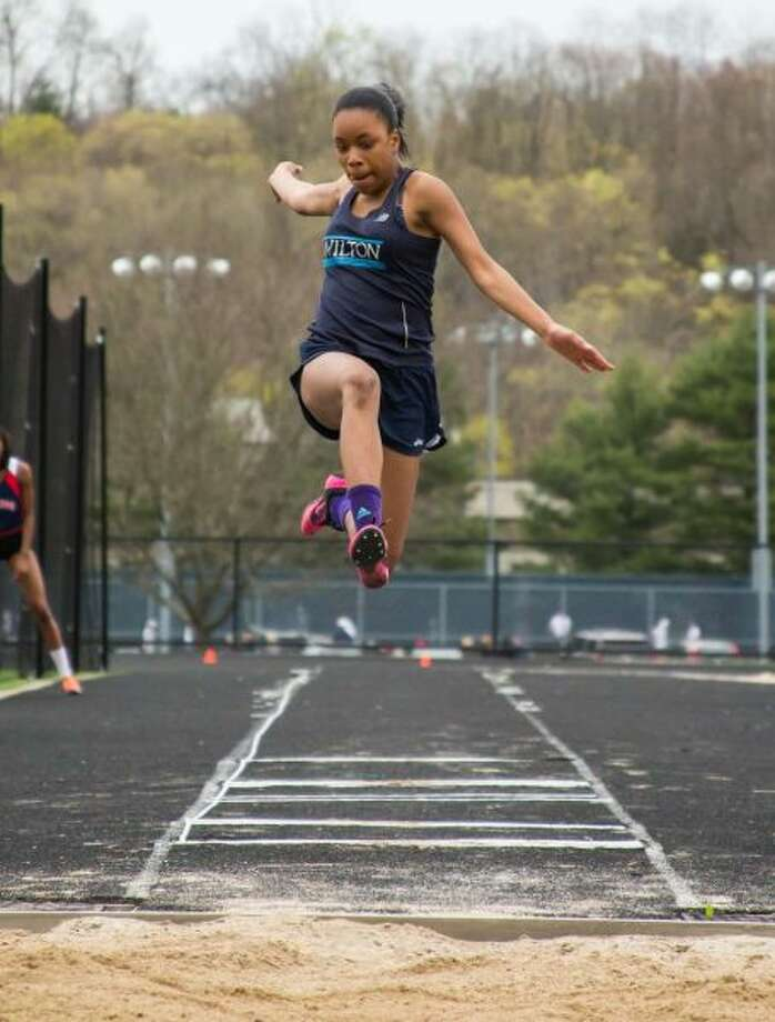 Andreen Reid, shown in action from last season, broke the Wilton High girls long jump for the second time this past Friday night. — GretchenMcMahonPhotography.com