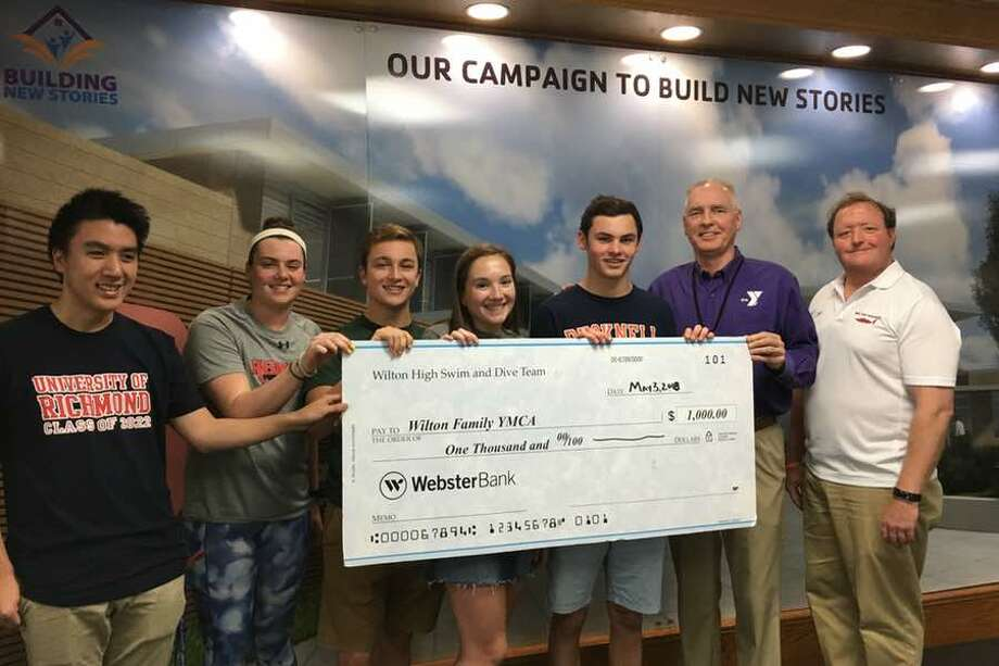 Wilton High boys and girls swim and dive captains present their annual donation of $1,000 to the Wilton Family YMCA. From the left, Jason Cai, Brooke Kelly, Jackson Dill, Emily Walden, Jack Lewis, Wilton YMCA CEO Bob McDowell and Wilton High swim coach Todd Stevens.