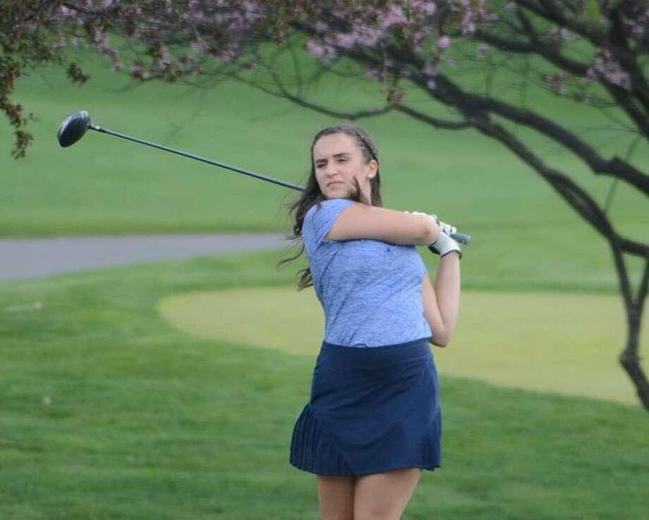Karli Williams watches her tee shot during the Wilton girls golf team's match on Thursday at Richter Park in Danbury. — J.B. Cozens photo
