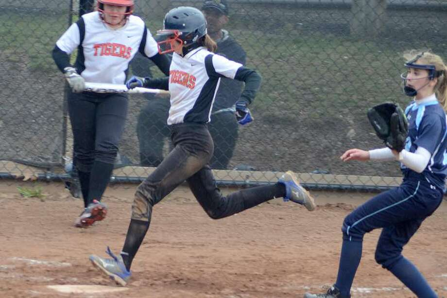 Mallory Shofi crosses the plate for the Ridgefield softball team during Monday's 10-6 win over Wilton at home. — J.B. Cozens photo