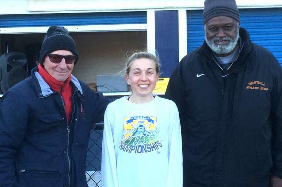 The Wilton High girls track and field meet on April 20 brought together three two-time FCIAC cross country champions. From the left: Westhill coach Ed Lane, who won FCIAC cross country titles in 1965 and 1966 running for Rippowam High of Stamford; Wilton senior Morgan McCormick, who won her second straight FCIAC title last fall; and Pomperaug coach Mark Goodwin, who ran for Danbury and won FCIAC cross country titles in 1967 and 1968.