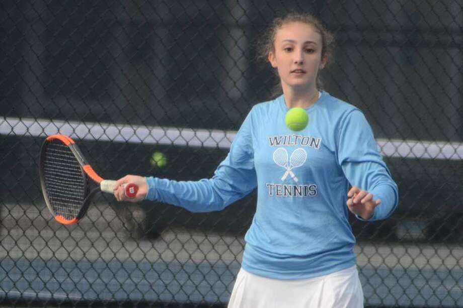 Gerri Fox and the Wilton High girls tennis team chalked up their fifth win of the season on Thursday in Ridgefield. — J.B. Cozens photo