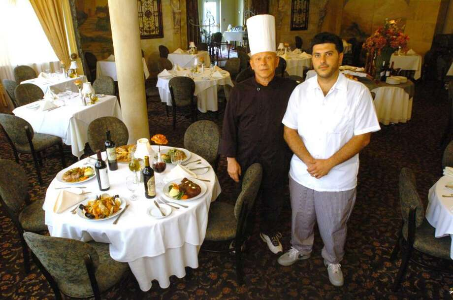 Michael Valeri and his son, Michael Jr., at La Fortuna restaurant in Bethel. La Fortuna is participating in Bethel Restaurant Week. Photo: Chris Ware / The News-Times