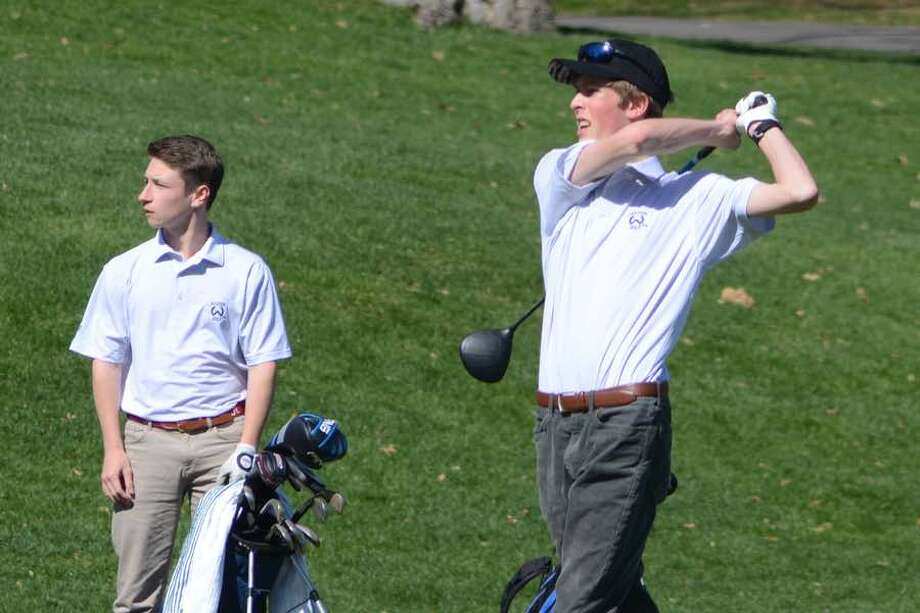 Will Kalin (left) and Jack Cromwell watch the flight of Cromwell's tee shot during the Wilton boys golf team's match on Monday at Rolling Hills Country Club. — J.B. Cozens photo