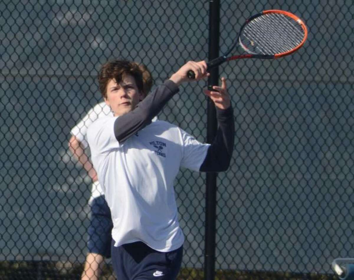 Conrad Emerson returns a volley during Wilton boys tennis action from earlier this season. - J.B. Cozens photo