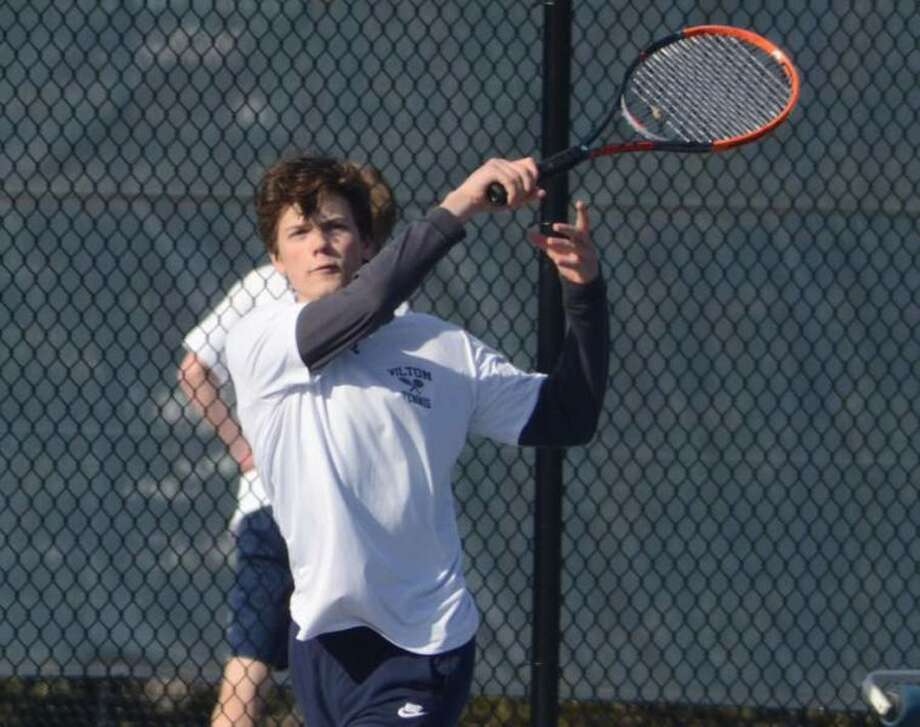 Conrad Emerson returns a volley during Wilton boys tennis action from earlier this season. — J.B. Cozens photo