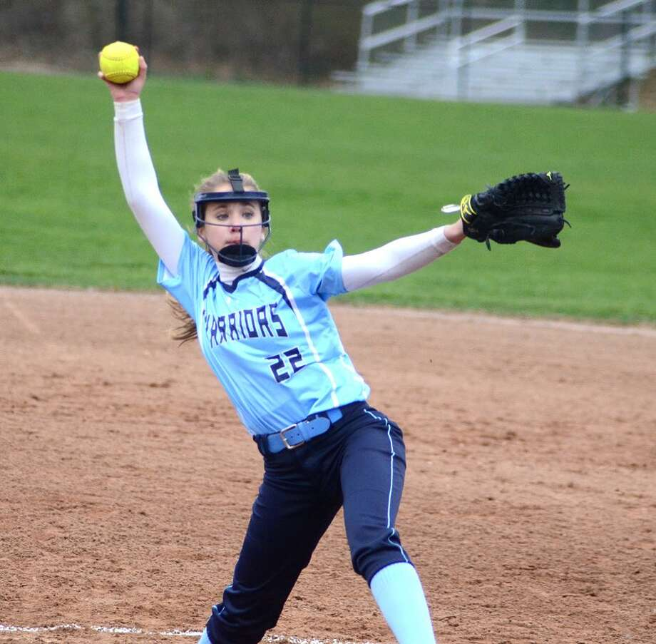 Claire Wilson gets set to deliver a pitch during the Wilton High softball team's 8-7 win over Staples at home on Tuesday. Wilson turned in a complete-game effort on the mound and scored the winning run in the bottom of the seventh. — J.B. Cozens photo