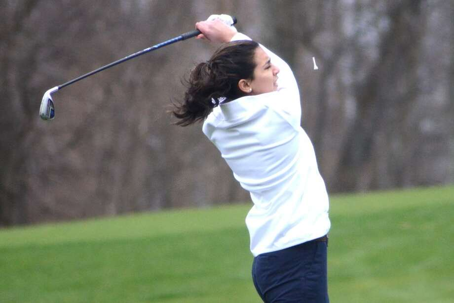 Maya Fazio watches her tee shot on the first hole during the Wilton High girls golf team's match on Tuesday at Silvermine Golf Club. — J.B. Cozens photo