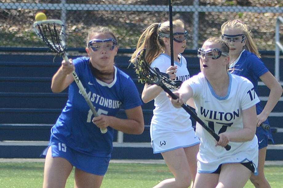 Emmy Goodwin puts the pressure on Glastonbury's Leah Suydam during the Wilton girls lacrosse team's win on Saturday. — J.B. Cozens photo