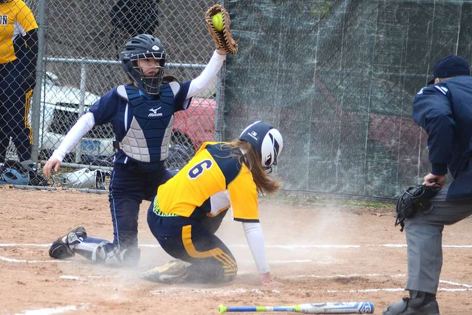 Maya Farrell puts the tag on Weston's Cassidy Nosenzo at the plate during the Wilton softball team's win on Thursday in Weston. — J.B. Cozens photo