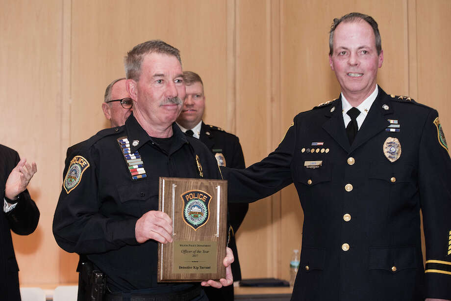 Det. Kip Tarrant accepts his Police Officer of the Year Award from Chief John Lynch. / BryanHaeffele