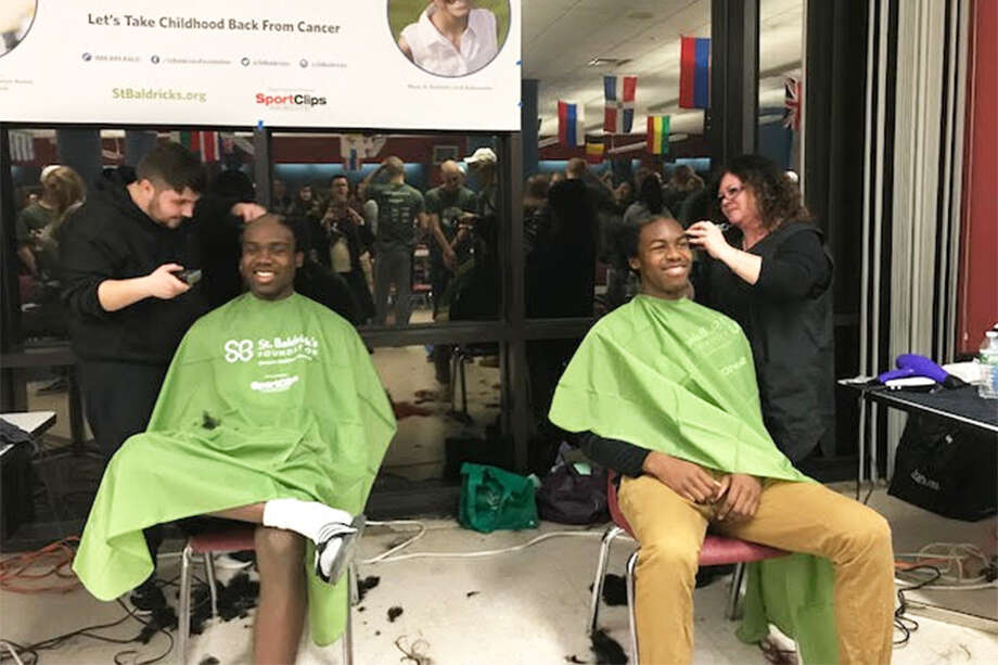 Wilton High School students and ABC scholars Joel and Josh Darkwah get their heads shaved at the St. Baldrick's event. — Contributed photo