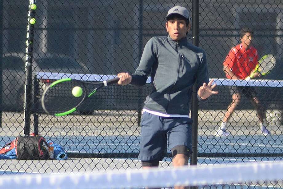 Rahul Vallabhajosula returns a volley during the Wilton boys tennis team's match against New Canaan on Thursday. — J.B. Cozens photo