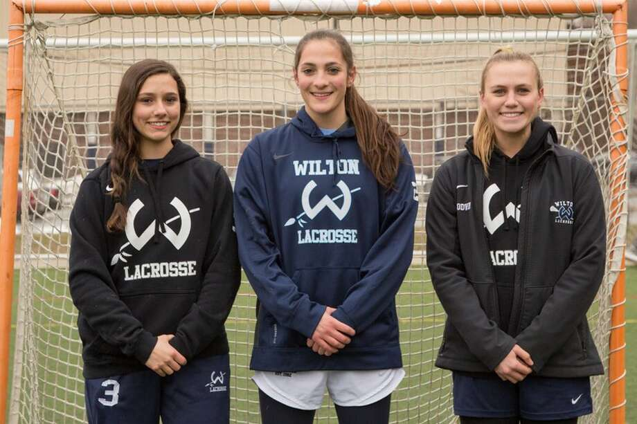 Captains of this year's Wilton High girls lacrosse team are, from the left: Paige Brown, Eva Greco and Emmy Goodwin. — GretchenMcMahonPhotography.com