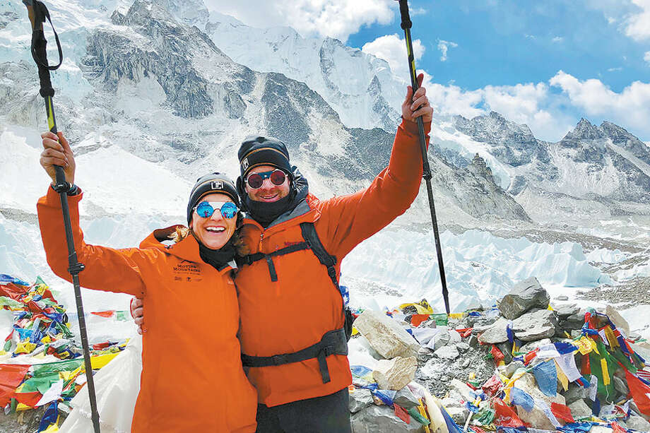 Annamarie and JP Kealy celebrate their ascent earlier this month to the Mount Everest base camp in Nepal. The Kealys participated in a fund-raising trek for the Multiple Myeloma Foundation.