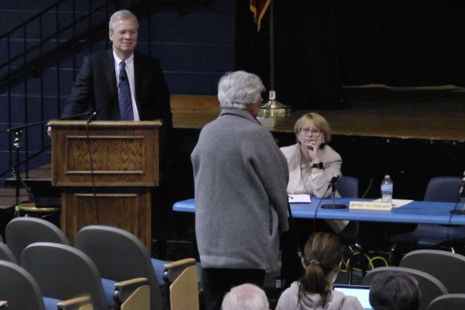 Board of Finance Chairman Jeff Rutishauser and First Selectwoman Lynne Vanderslice listen to Pat Hessel speak in favor of funding for Wilton Library.