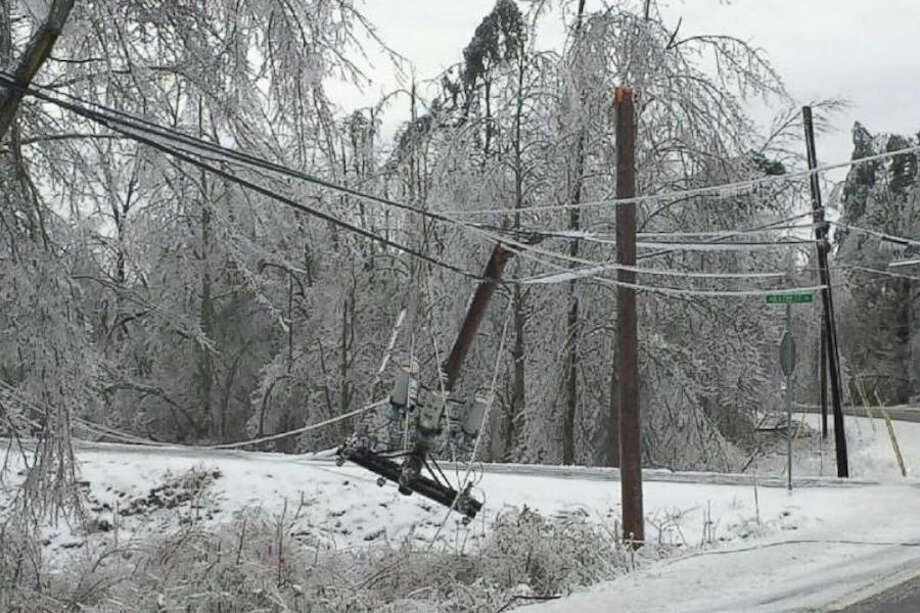 A utility pole snapped on Dudley Road. — Tina Pamnani photo