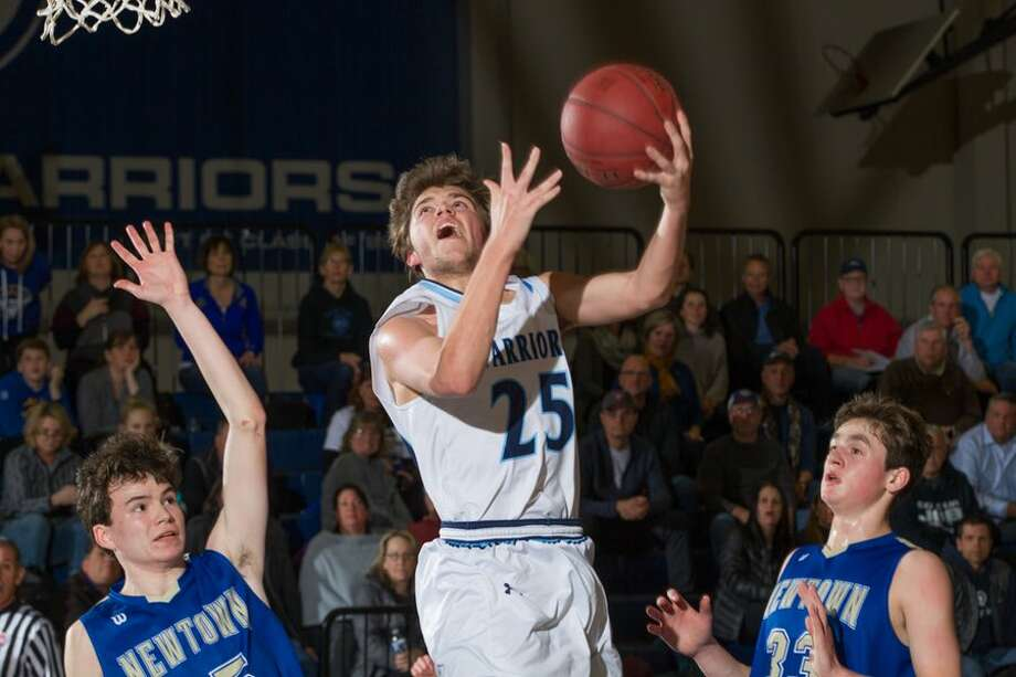 Kyle Hyzy takes the ball to the rim during the Wilton High boys basketball team's loss to Newtown on Monday night in the Division II state quarterfinals. — GretchenMcMahonPhotography.com
