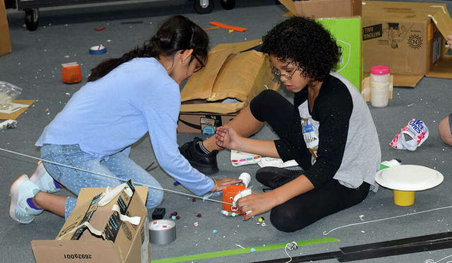 Gabie (left) and Adelisa work on a STEM project Thursday at Camp Invention at Eisenhower Elementary School. Photo: Marco Cartolano | Journal-Courier
