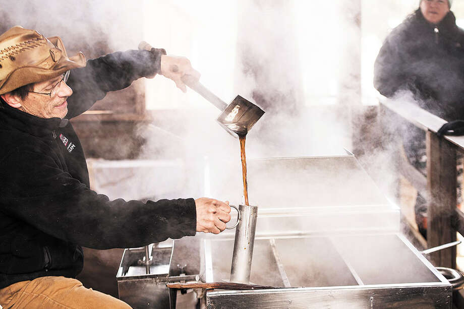 Kevin Meehan demonstrates the evaporating process in making maple syrup. / BryanHaeffele