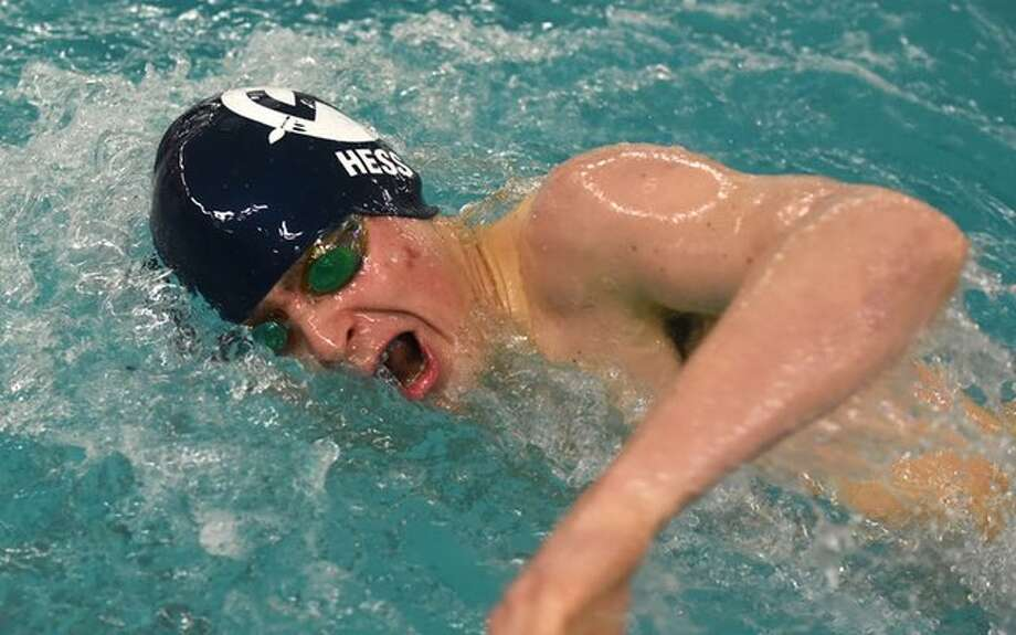 Rory Hess swims a leg in the 400-yard freestyle relay for the Wilton High boys swim team at Sunday's FCIAC championships in Greenwich. — Dave Stewart / HAN Network