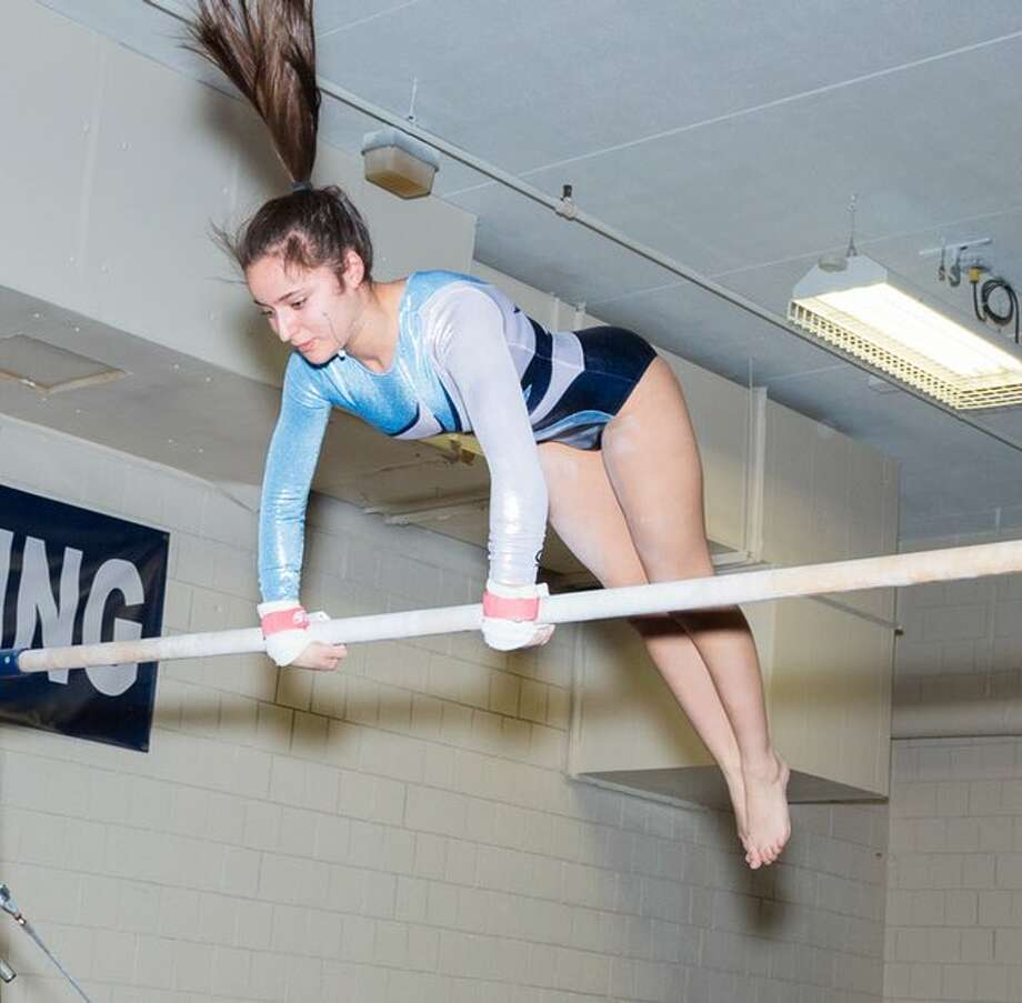 Wilton's Brooke Taffler earned second-team all-state honors with top 40 finishes on bars and vault at Saturday's State Open gymnastics championships. — GretchenMcMahonPhotography.com