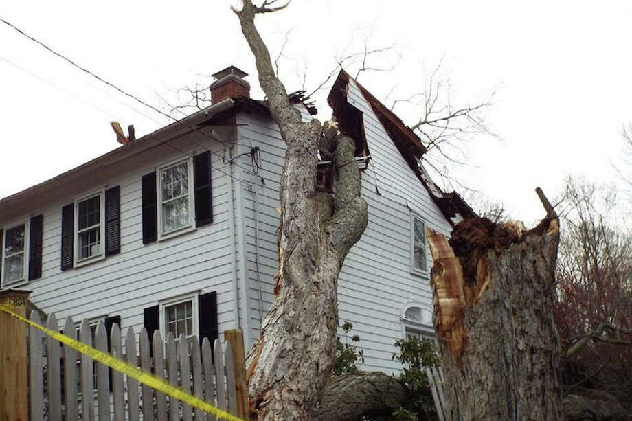This house on Grumman Hill Road sustained significant damage due to Friday's storm.