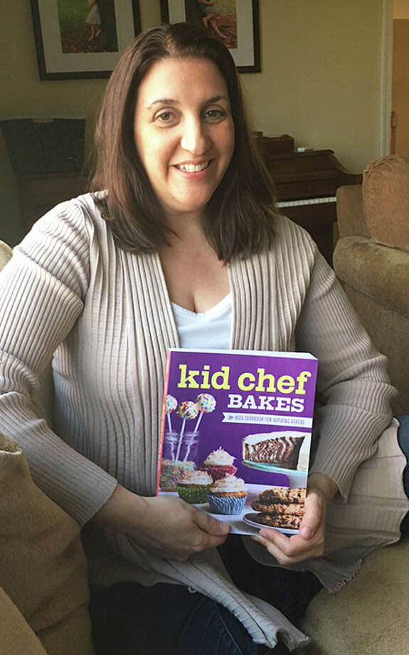 Lisa Huff with her new children's cookbook, Kid Chef Bakes. — Contributed photo